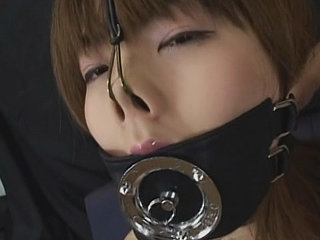 Asian chick ball-gagged and suck cock